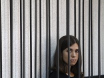A member of the female punk band 'Pussy Riot', Tolokonnikova, looks out from a holding cell as she attends a court hearing to appeal for parole at the Supreme Court of Mordovia in Saransk