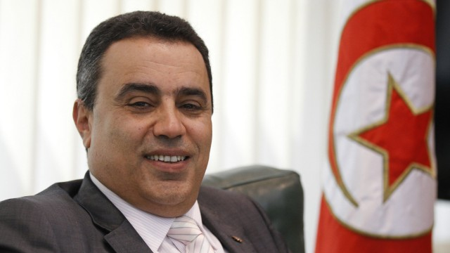 Tunisia's Industry Minister Mehdi smiles in his office in Tunis