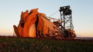 An excavator operates at the open-cast Garzweiler brown coal mine of German power supplier RWE near the village of Borschemich west of Cologne