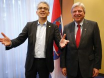 al Wazir leader of Hesse's green party Buendnis 90/Gruene gestures as he stands next to Hesse's conservative Christian Democratic Union (CDU) leader and state premier Minister Bouffier prior to the start of their coalition talks at a hotel in Wiesbaden