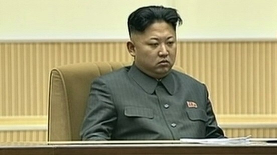 Still image from video of North Korean leader Kim Jong Un attending a mass indoor memorial rally in Pyongyang