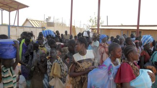 Displaced Sudanese civilians arrive at the United Nations Mission in the Republic of South Sudan compound on the outskirts of the capital Juba