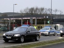 A convoy of cars which are belived to carry former oil tycoon Khodorkovsky is escorted by German police as they leave the Schoenefeld airport in Berlin