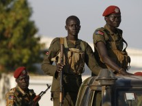 SPLA soldiers stand in a vehicle in Juba
