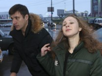 Alyokhina, member of Russian punk band Pussy Riot, speaks to the media at a train station in Nizhny Novgorod