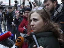 Alyokhina, member of Russian punk band Pussy Riot, speaks to the media after her release from a penal colony in Nizhny Novgorod