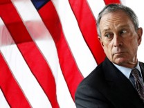 File photo of New York Mayor Bloomberg looking out a window during a news conference announcing a lease for commercial office space to the law firm WilmerHale