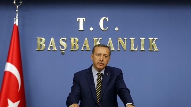 Turkey's Prime Minister Tayyip Erdogan addresses the media in Ankara