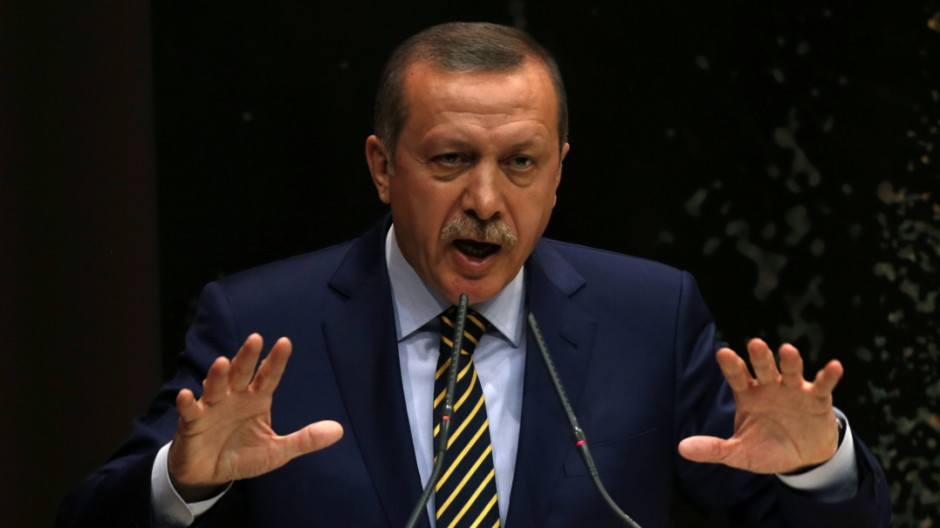 Turkey's Prime Minister Tayyip Erdogan addresses members of his ruling AK Party in Ankara
