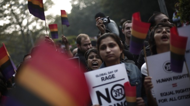 Gay rights activists hold placards as they shout slogans during a protest against a verdict by the Supreme Court in New Delhi