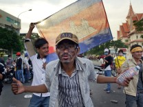 Striking Cambodian Garment Workers Join Opposition Party Protesters In Phnom Penh