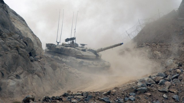 Canadian Leopard 2 tank climbs up to take a position at the top of hill in Camp Masoom Ghar in Panjwa'i district