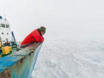 Icebound Antarctic research vessel awaits icebreaker release