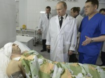 Russia's President Putin meets a survivor of one of the recent bombings at a local hospital in Volgograd