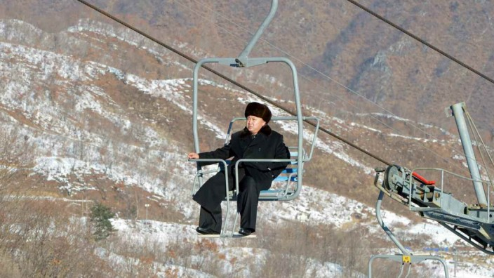 North Korean leader Kim Jong Un sits on a ski lift during a visit to a newly built ski resort in the Masik Pass region