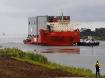 The first four new gates for the Panama Canal's third set of locks are seen on top of a cargo ship during their arrival to Colon in Colon City