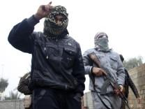 Sunnitische Rebellen in den Straßen von Falludscha