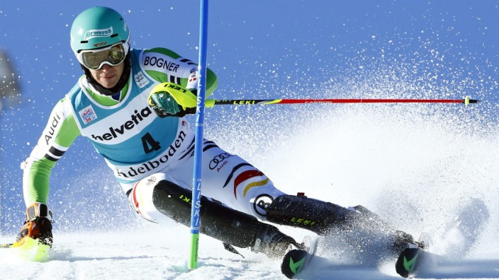 Neureuther of Germany clears a gate during the first run of the men's World Cup Slalom ski race in Adelboden