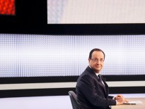 France's President Hollande is seen before appearing on France 2 television prime time news broadcast for an interview at their studios in Paris