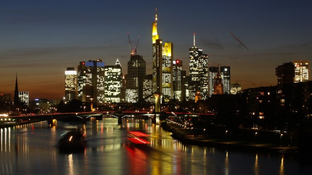 Ships are seen on river Main in front of the characteristic skyline with its banking towers in Frankfurt