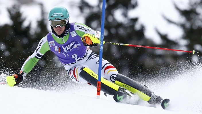 Neureuther of Germany clears a gate during the first run of the men's World Cup slalom ski race in Wengen