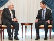 Syria's President Assad meets Iran's Foreign Minister Zarif in Damascus