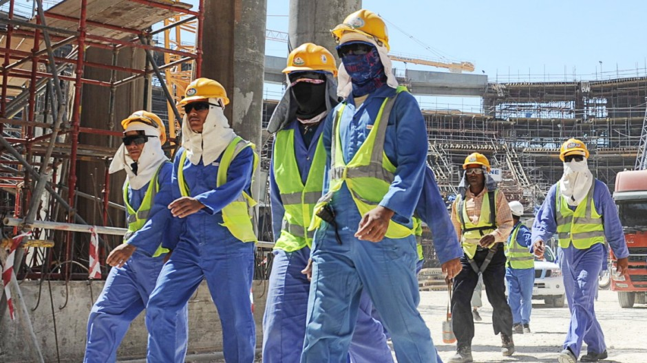 Foreign laborers work in Doha