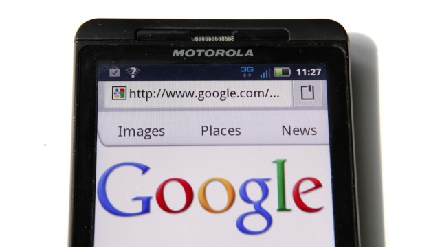 File of a Google homepage is displayed on a Motorola Droid phone in Washington