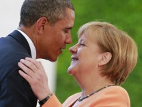 File photo of U.S. President Obama embracing German Chancellor Merkel outside the Chancellery in Berlin