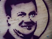 Picture shows stencil graffiti of Ukrainian President Viktor Yanukovich at anti-government barricade in Kiev