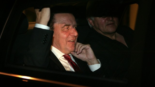 German Chancellor Schroeder leaves talks between Germanys conservative parties and Social Democrats in Berlin