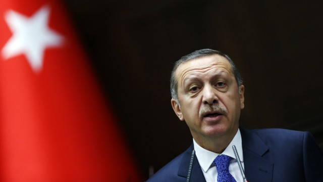 Turkey's PM Erdogan addresses members of parliament from his ruling AK Party during a meeting at the Turkish parliament in Ankara
