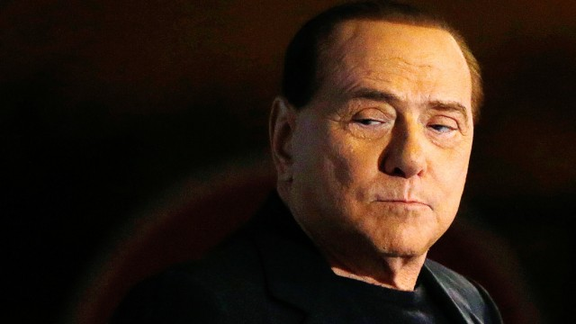 File photo of Italy's former Prime Minister Silvio Berlusconi looking on during a speech from the stage in downtown Rome
