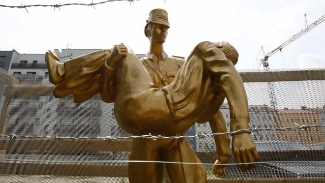 General view of  'Mauerdenkmal 1000' sculpture by artist Brauer at former Berlin Wall site in Bernauer Strasse