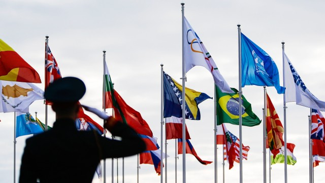 A Russian soldier salutes during the welcoming ceremony for the Olympic teams of Sweden, Italy and the Netherlands in the Athletes Village in Sochi