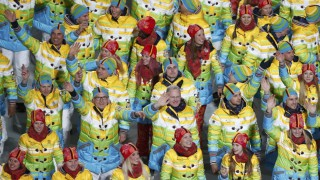 Germany's flag-bearer Maria Hoefl-Riesch leads her country's contingent during the opening ceremony of the 2014 Sochi Winter Olympics