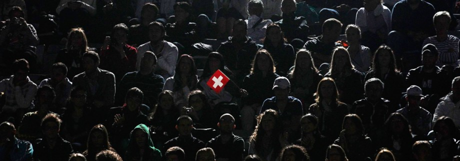 File photo of tennis supporter holding Swiss national flag