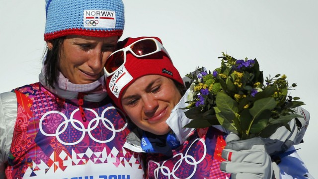 Norway's Bjoergen and Weng cry as they celebrate after women's cross-country skiathlon event at 2014 Sochi Winter Olympics