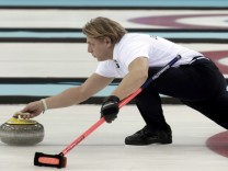 Germany's skip John Jahr delivers a stone during their men's curling round robin session game against Norway at the 2014 Sochi Olympics