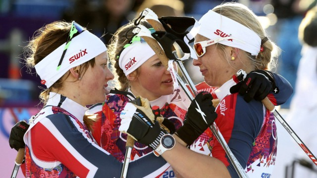 Winner Falla of Norway and her team mate, second placed Oestberg comfort Jacobsen after competing in the women's cross-country sprint free final at the Sochi 2014 Winter Olympic Games in Rosa Khutor