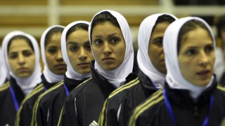 Iran's women's soccer team lines up during the opening ceremony of the 5th Amman International Women Soccer Championship in Amman