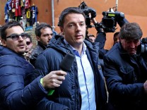 Italian Democratic Party leader Matteo Renzi arrives for party me