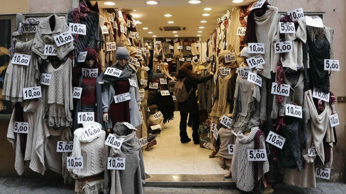 Clothes are seen displayed in a shop in downtown Rome