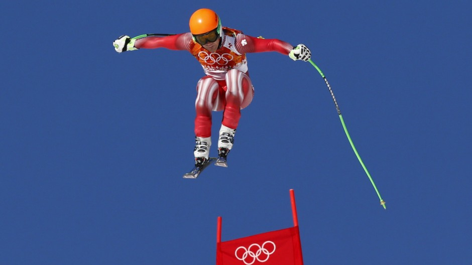 Switzerland's Viletta goes airborne during the slalom run of the men's alpine skiing super combined event at the 2014 Sochi Winter Olympics