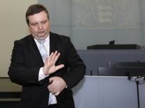 Former Baden-Wuerttemberg premier Mappus (CDU) gestures before hearing at EnBW commission of enquiry in Stuttgart