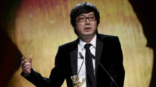 Chinese director Diao speaks during the awards ceremony of the 64th Berlinale International Film Festival in Berlin