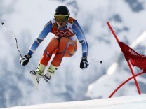 Norway's Jansrud takes a jump during the men's alpine skiing Super-G competition at the 2014 Sochi Winter Olympics