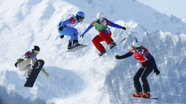 Faye Gulini of U.S., Austria's Maria Ramberger, France's Nelly Moenne Loccoz and Eva Samkova of Czech Republic compete during women's snowboard cross quarter-finals at 2014 Sochi Winter Olympic Games in Rosa Khutor