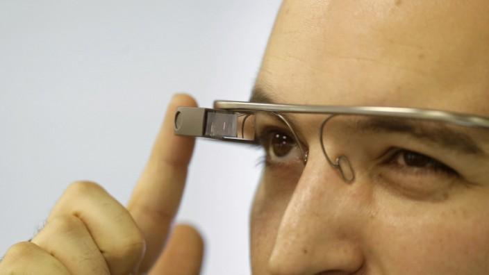 Developer Firtman wears Google Glass before news conference in Riga
