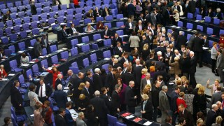 Parliamentarians cast their votes after debate about deputy allowances and graft at lower house of parliament in Berlin